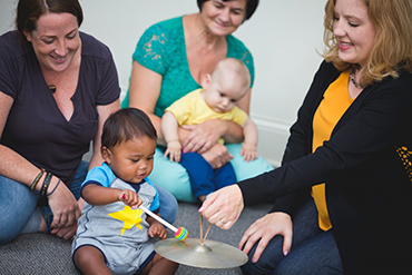 Parents and Babies playing percussion instruments